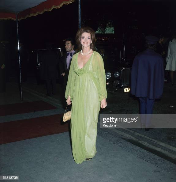 American actress Gayle Hunnicutt arrives at the premiere of 'Juggernaut' in Leicester Square wearing a lime green evening dress October 1974 The film...