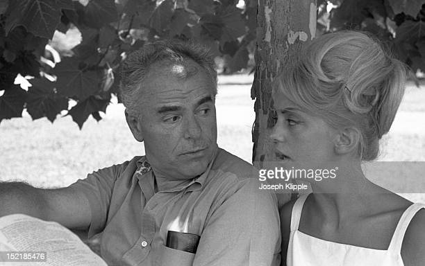American actress Goldie Hawn sits under a tree with her College of William and Mary theater professor Howard Scammon as they discuss the play 'Romeo...