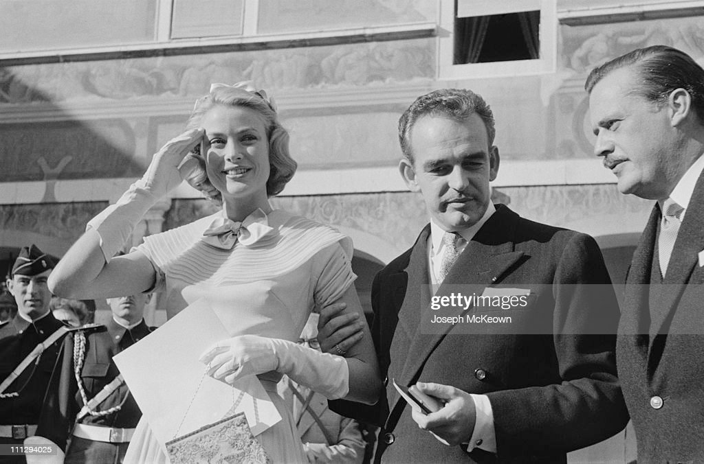 American actress Grace Kelly (1929 – 1982) and Rainier III, Prince of Monaco (1923 – 2005, centre) on the day of their civil wedding ceremony at the Prince's Palace of Monaco, 18th April 1956. Original publication: Picture Post - 8336 - The Hour Of Marriage - pub. 28th April 1956