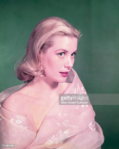 American actress Grace Kelly in a pink wrap circa 1955
