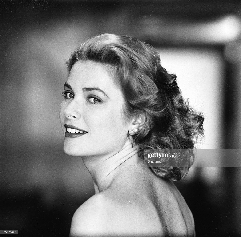 American actress Grace Kelly in a strapless gown as she looks over her shoulder Hollywood California March 1954 The following April Kelly married...