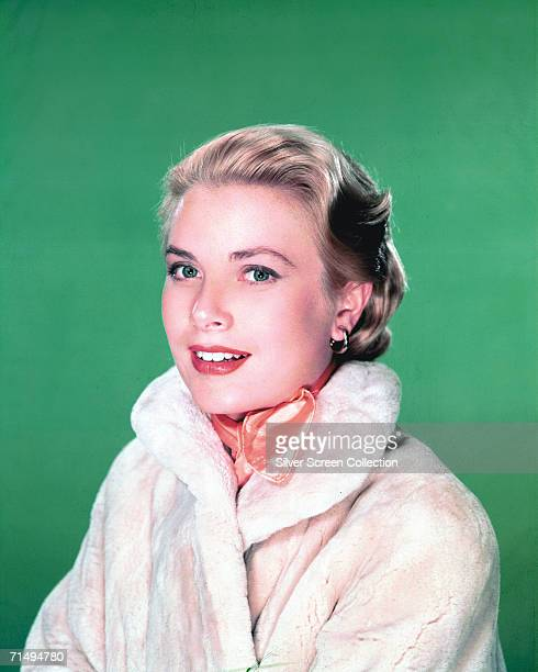 American actress Grace Kelly in a white fur coat circa 1960