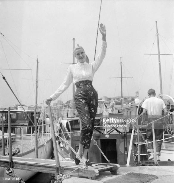American actress Grace Kelly waves on a boat in Cannes for the international film festival in April May 1955 in Cannes France This is on this trip...