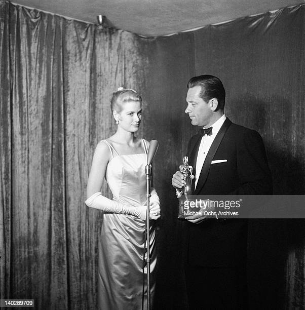 American actress Grace Kelly with William Holden at the Academy Awards held at the Pantages Theatre in Hollywood California 30th March 1955