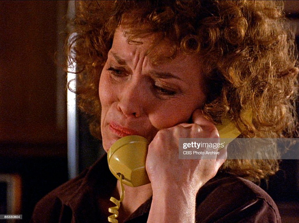 American actress Grace Zabriskie (as Sarah Palmer) fights back grief as she talks on a telephone in a scene from the pilot episode of the television series 'Twin Peaks,' originally broadcast on April 8, 1990.