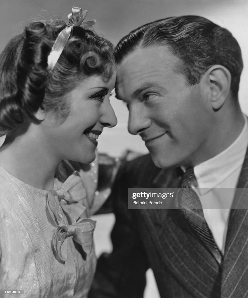 American actress Gracie Allen and her husband actor George Burns with their foreheads touching in 1941