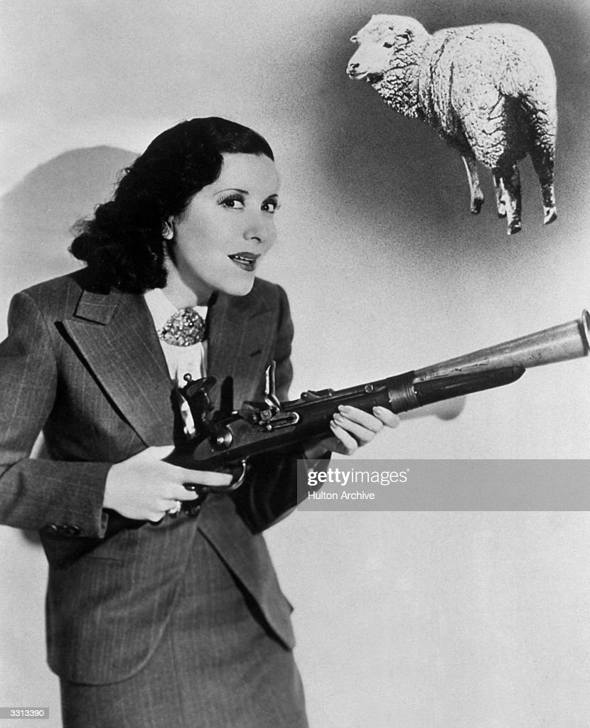 American actress Gracie Allen gets her gun in the Paramount production 'College Swing' directed by Raoul Walsh