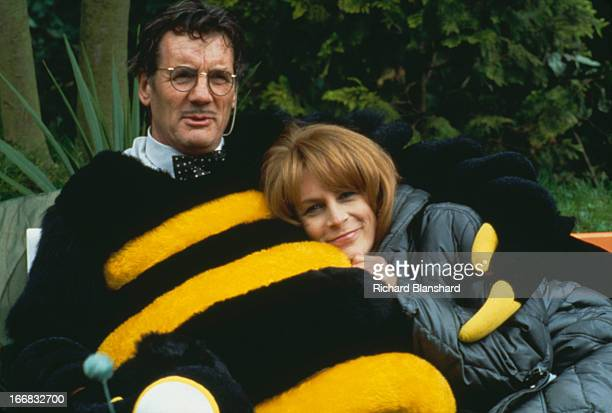 American actress Jamie Lee Curtis stars with English actor and comedian Michael Palin who is wearing a bee costume in the film 'Fierce Creatures' 1997