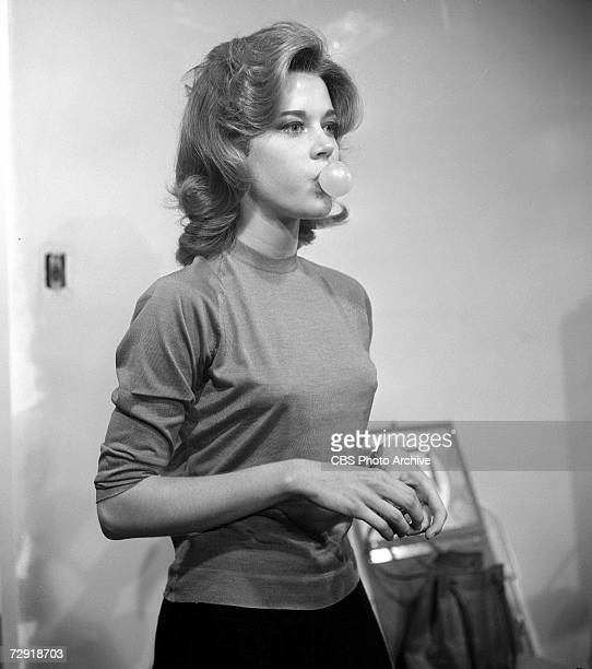 American actress Jane Fonda blows a bubble with her chewing gum in her W 55th St apartment on an episode of the CBS celebrity interview program...