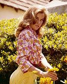 American actress Jane Fonda in a pink floral blouse and yellow slacks circa 1968