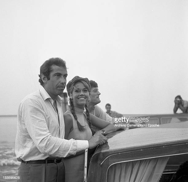 American actress Jane Fonda with her brother Peter Fonda and her husband Roger Vadim portrayed on a water taxi crossing the Canal Grande Venice 1967