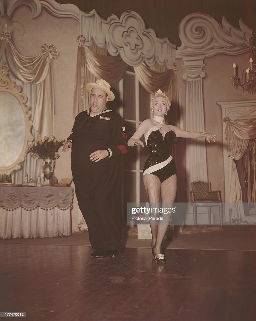American actress Jane Powell and actor Jack E Leonard in a scene from the Warner Brothers film 'Three Sailors and A Girl' 1953