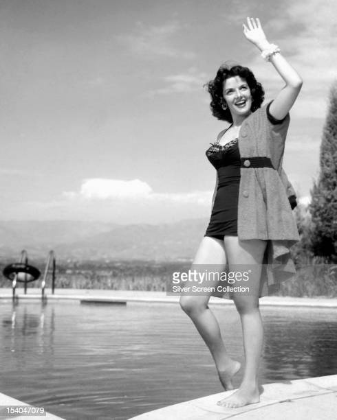 American actress Jane Russell by a swimming pool circa 1955