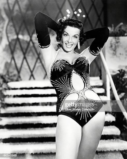 American actress Jane Russell wearing evening gloves and a cutaway onepiece swimsuit in a promotional portrait for the 3D musical comedy 'The French...