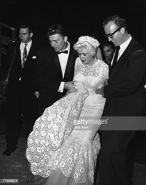 American actress Jayne Mansfield and her second husband Mickey Hargitay make their way to the dressing room after their wedding at Palos Verdes 13th...