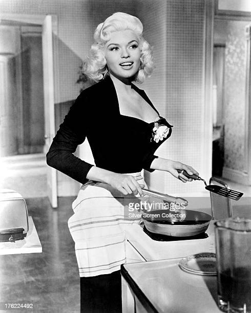 American actress Jayne Mansfield cooking in a scene from 'The Girl Can't Help It' directed by Frank Tashlin 1956