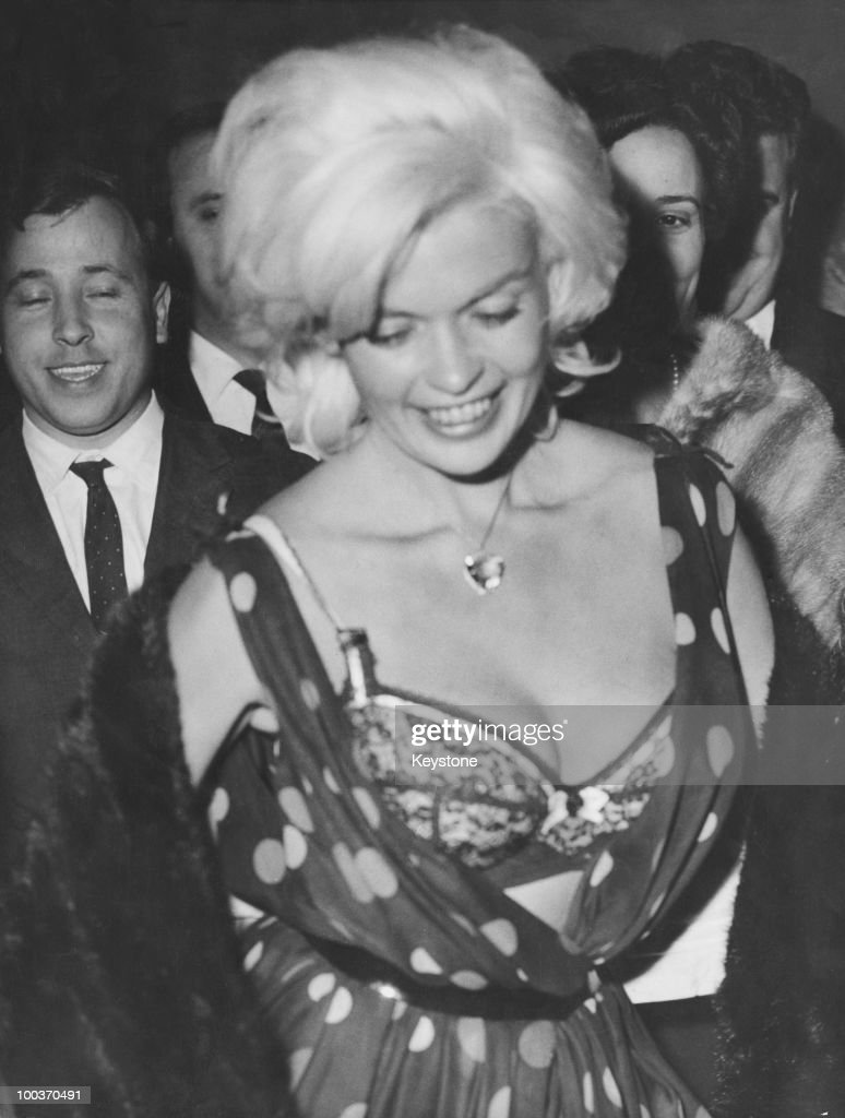 American actress <a gi-track='captionPersonalityLinkClicked' href=/galleries/search?phrase=Jayne+Mansfield&family=editorial&specificpeople=91204 ng-click='$event.stopPropagation()'>Jayne Mansfield</a> (1933 - 1967) experiences a wardrobe malfunction at a nightclub in Rome, 13th June 1962.