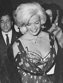 American actress Jayne Mansfield experiences a wardrobe malfunction at a nightclub in Rome 13th June 1962