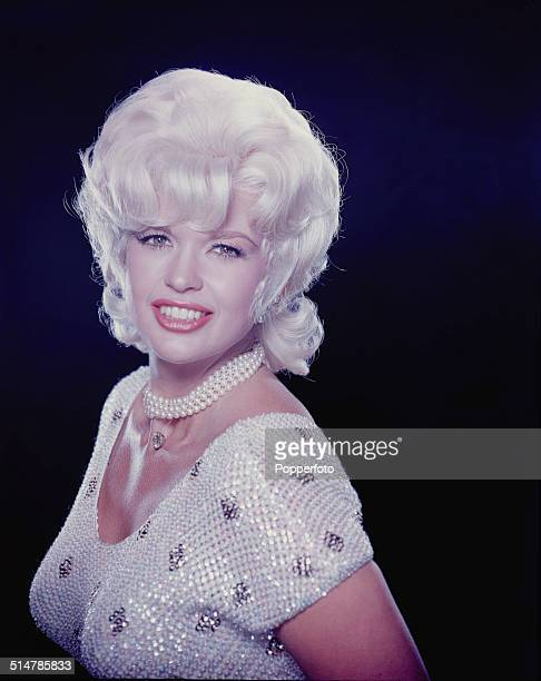 American actress Jayne Mansfield posed wearing sparkling dress with pearl necklace and diamond pendant circa 1960