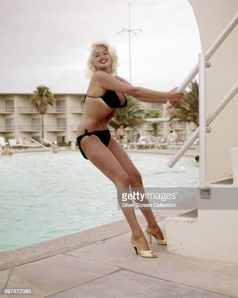 American actress Jayne Mansfield poses by a swimming pool circa 1960