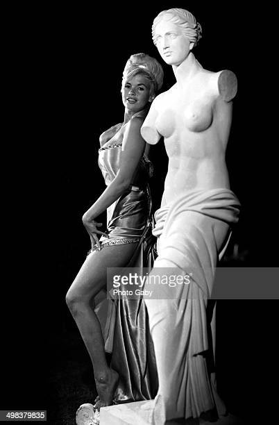 American actress Jayne Mansfield posing next to a classical sculpture Montreal Canada 1966