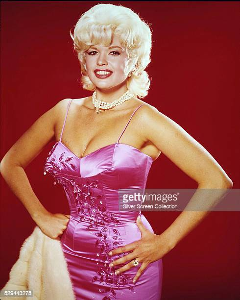 American actress Jayne Mansfield wearing a pink satin dress circa 1960