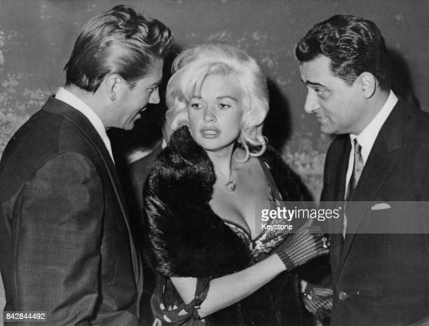 American actress Jayne Mansfield with her husband Mickey Hargitay and Italian film executive Enrico Bomba in Rome Italy July 1962 Mansfield and Bomba...