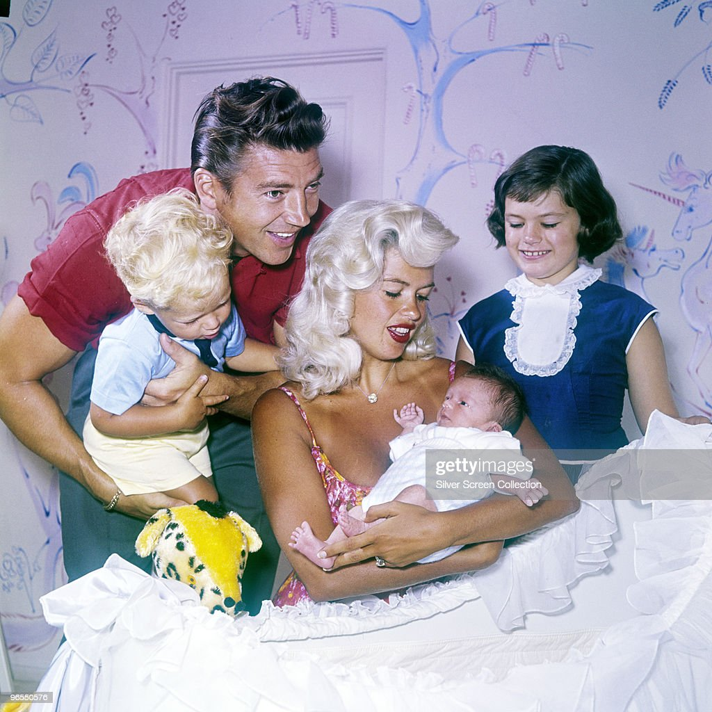 American actress <a gi-track='captionPersonalityLinkClicked' href=/galleries/search?phrase=Jayne+Mansfield&family=editorial&specificpeople=91204 ng-click='$event.stopPropagation()'>Jayne Mansfield</a> with her husband <a gi-track='captionPersonalityLinkClicked' href=/galleries/search?phrase=Mickey+Hargitay&family=editorial&specificpeople=233644 ng-click='$event.stopPropagation()'>Mickey Hargitay</a> and their children (left to right) Miklos, Zoltan and Jayne Marie, 1960.