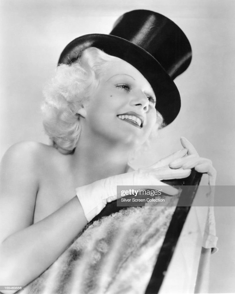 American actress Jean Harlow wearing a top hat in a promotional portrait for 'Bombshell' directed by directed by Victor Fleming 1933