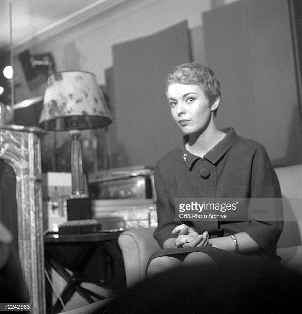 American actress Jean Seberg sits in her living room during an episode of the CBS celebrity interview program 'Person to Person' October 1960