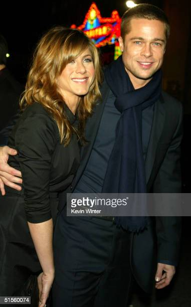 American actress Jennifer Aniston and actor Brad Pitt attend the Los Angeles premiere of Universal Pictures' film 'Along Came Polly' at the Grauman's...