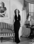 American actress Joan Crawford as she appeared in Edward H Griffith's 'No More Ladies' wearing a gown by Adrian