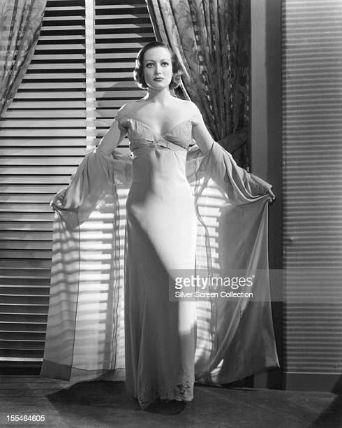 American actress Joan Crawford in a white nightdress and peignoir circa 1930