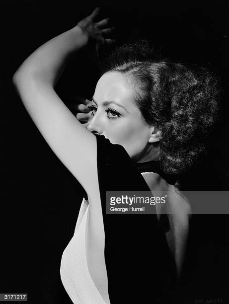 American actress Joan Crawford wearing a backless dress