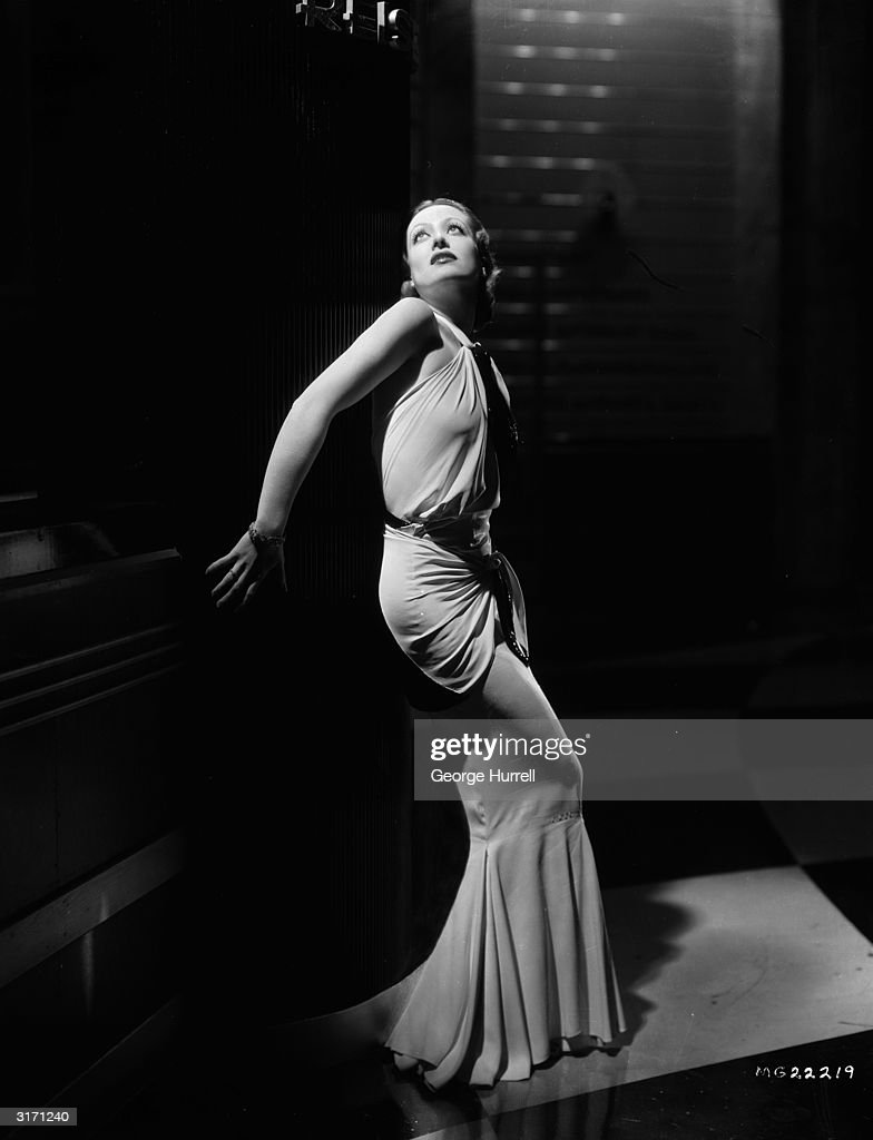 American actress Joan Crawford wearing a dress designed by Adrian for her role in 'Letty Lynton'
