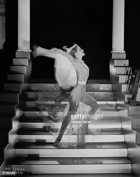 American actress Joan Crawford wearing a glittering costume by Adrian for her role in Robert Z Leonard's 'Dancing Lady' Born Lucille LeSueur in Texas...