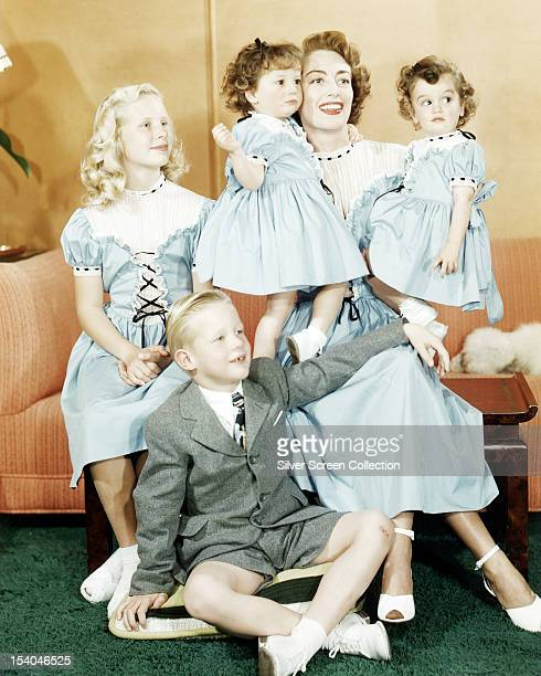 American actress Joan Crawford with her daughter Christina her son Christopher and her adopted identical twin daughters Cindy and Cathy circa 1949