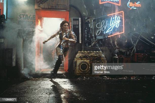 American actress Joanna Cassidy as the replicant Zhora flees the nightclub where she works after being identified by 'blade runner' Rick Deckard in a...