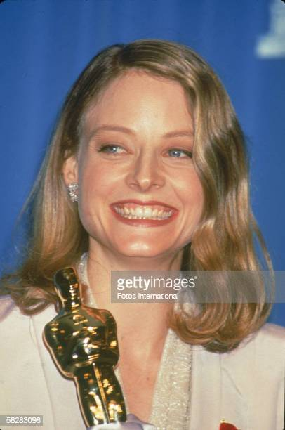 American actress Jodie Foster poses backstage with her 'Oscar' award for Best Actress in a Leading Role for her performance in the film 'The Silence...