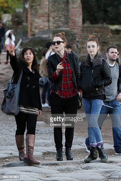 American actress Julianne Moore with her daughter Liv Freundlich are sighted on a Christmas holiday at via del Corso on December 21 2014 in Rome Italy