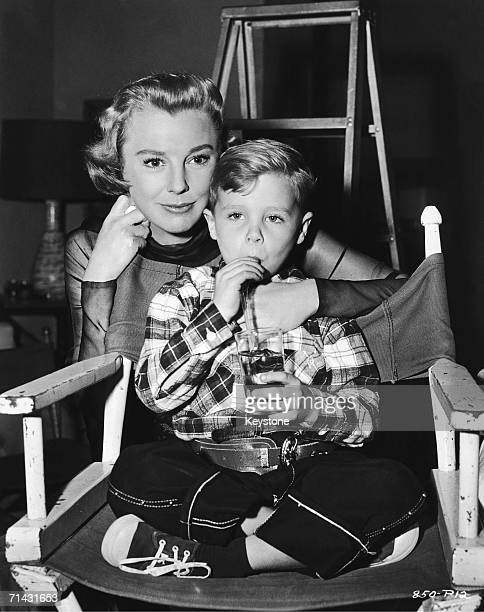 American actress June Allyson gets a visit from her son Ricky on the set of the Universal film 'My Man Godfrey' in which she stars 1956