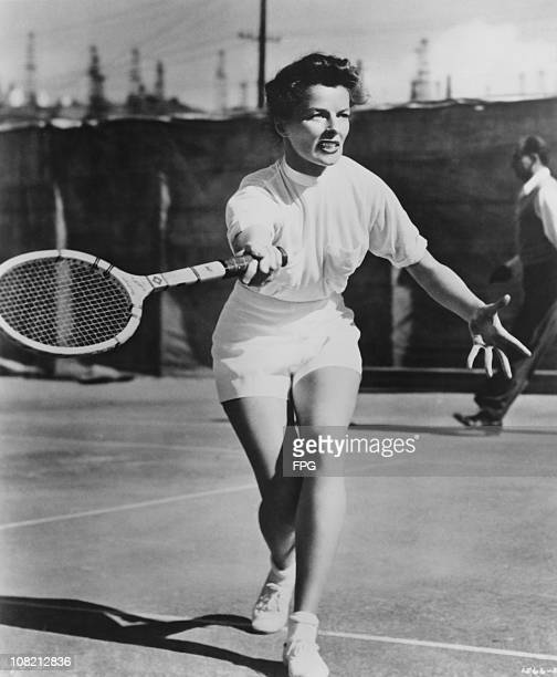 American actress Katharine Hepburn playing tennis circa 1945