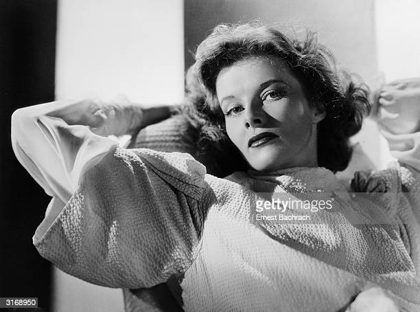 American actress Katharine Hepburn relaxes with her hands behind her head