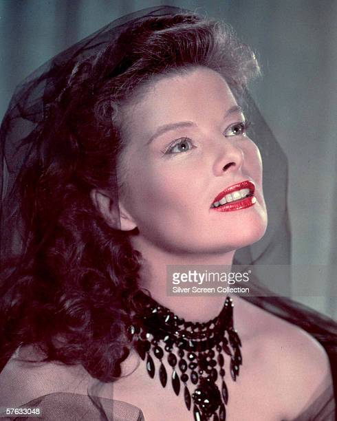 American actress Katharine Hepburn wearing a necklace of jet beads and a black veil 1940