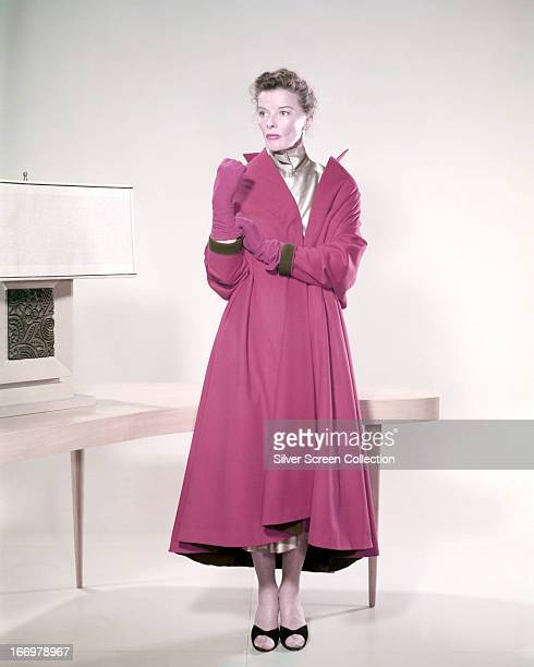 American actress Katharine Hepburn wearing a pink coat and matching gloves circa 1955