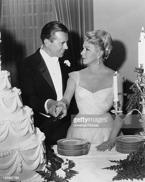 American actress Lana Turner marries actor John Forsythe in a scene from the Ross Hunter film 'Madame X' 1966