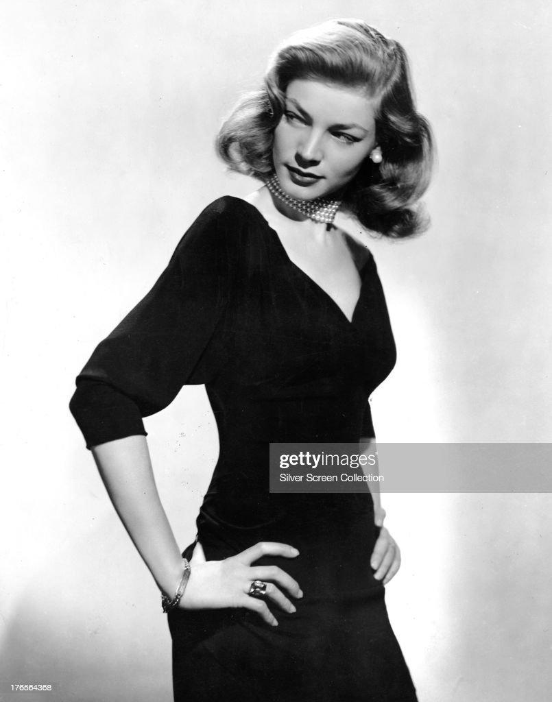 American actress Lauren Bacall wearing a black dress and pearl choker circa 1945