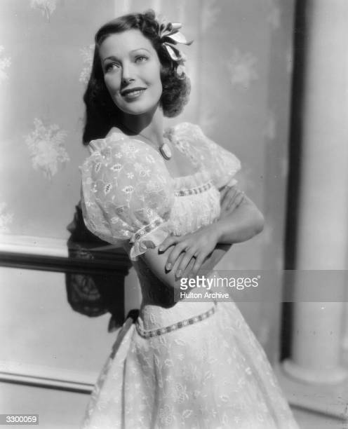 American actress Loretta Young in a scene from 'Kentucky' wearing a frock of eyelet organdie with blue velvet ribbon outlining the sleeves and...