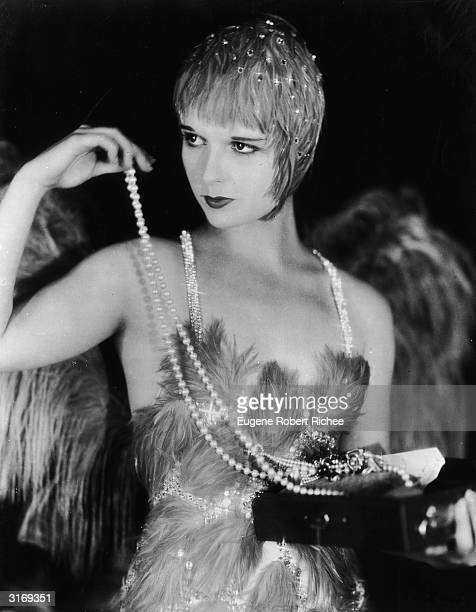 American actress Louise Brooks in costume for her role in 'The Canary Murder Case' in which she plays a scheming nightclub singer with a sideline in...