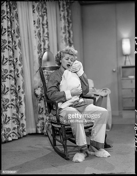 American actress Lucille Ball appears as Lucy Ricardo in an episode of 'I Love Lucy' Los Angeles California March 20 1953 She holds a baby wrapped in...